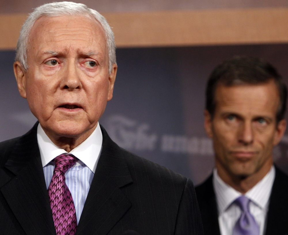 Sen. Orrin Hatch, left, wants to jettison the Health Care Act's coverage requirement. He and two others will unveil a proposed plan Thursday.
