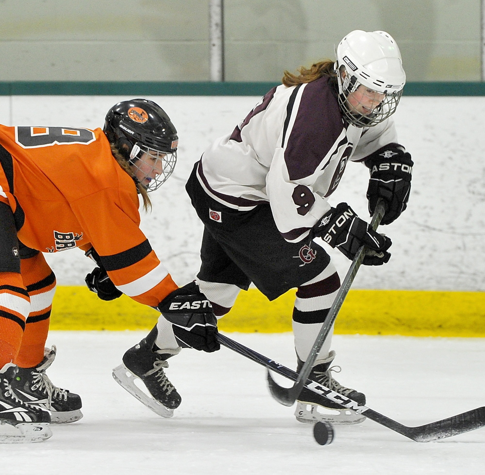 Anna Webster, left, disrupts the fast break by Greely's Maura Perry during Wednesday's playoff game at Family Ice in Falmouth.
