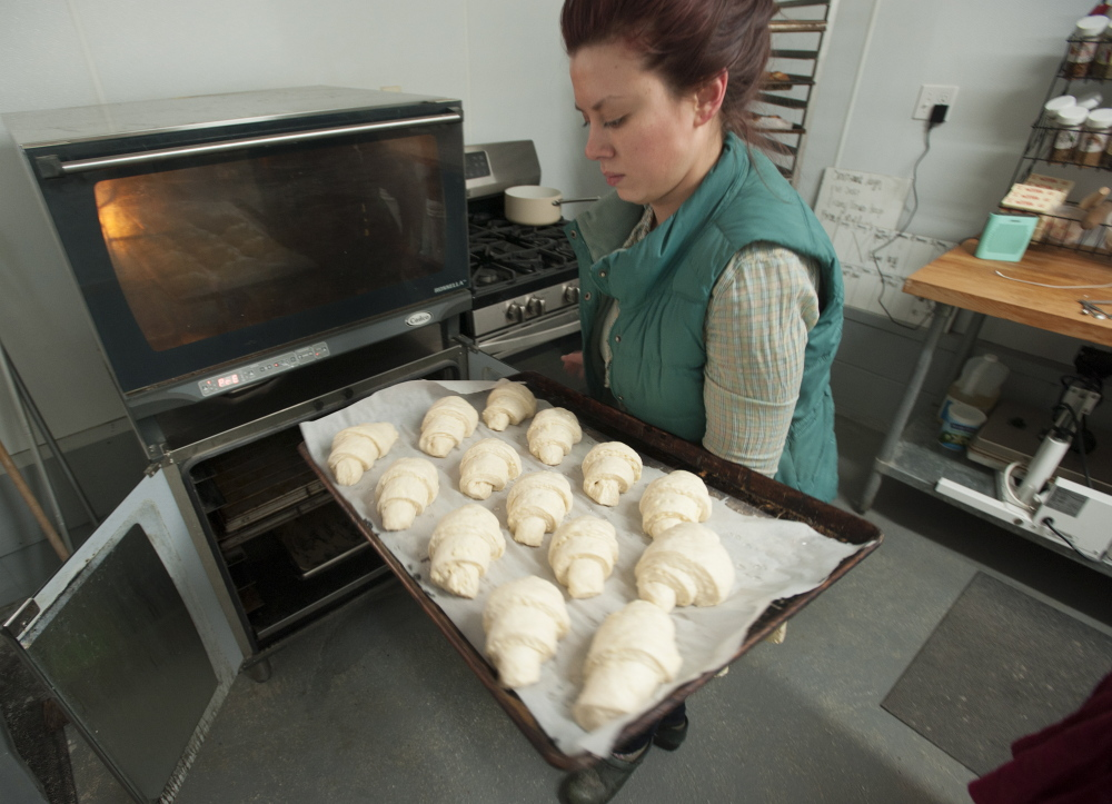 Natasha Colbry sells the breads and pastries she bakes at the farm both online and in local markets. The Colbrys, like other farmers, need reliable Internet connections to do business.
