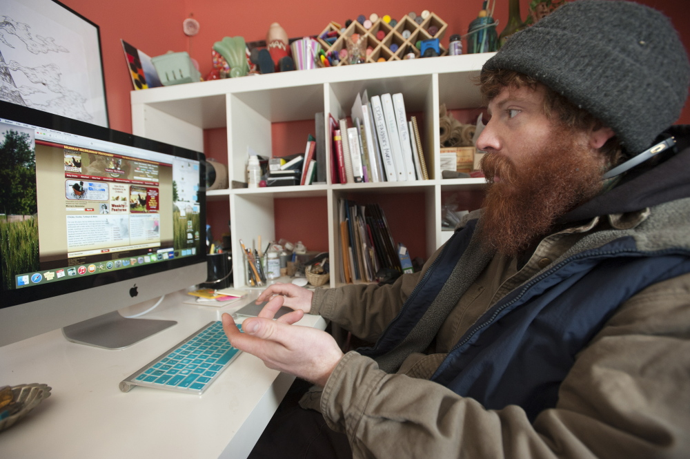 """I could not operate with out the Internet,"" says Dustin Colbry as he sits in front of a computer screen in his office at Spruce Mill Farm in Dover-Foxcroft on Tuesday. Colbry does everything from ordering laying hens to selling his farm goods using the Internet."