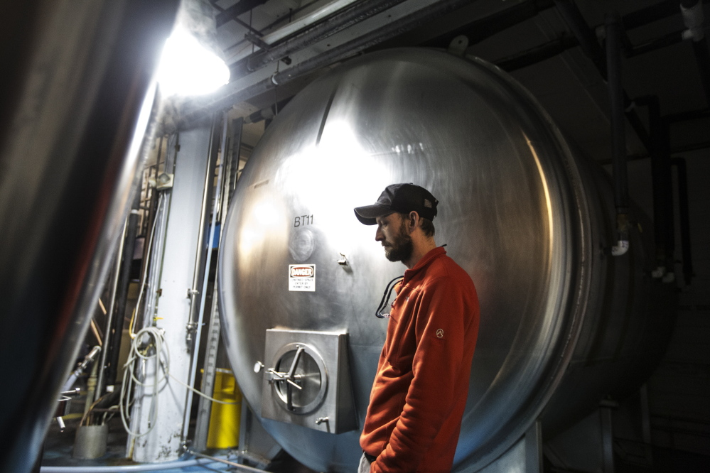Rob Griffin waits for a beer tank to rinse at Shipyard Brewery Co. in Portland on Wednesday. The Maine Legislature could soon make it easier for new brewers to break into the state's growing craft beer market. A bill requested by Shipyard would allow large breweries with excess production capacity to form tenant agreements with as many as nine smaller beer companies to lease brewing time on their equipment. Right now, large brewers can host only one tenant brewery. Whitney Hayward/Staff Photographer