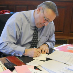 Gov. Paul LePage makes a note while drafting his State of the State speech. Exporting the tax burden, giving low-income workers a break and targeting property tax relief are the right principles.