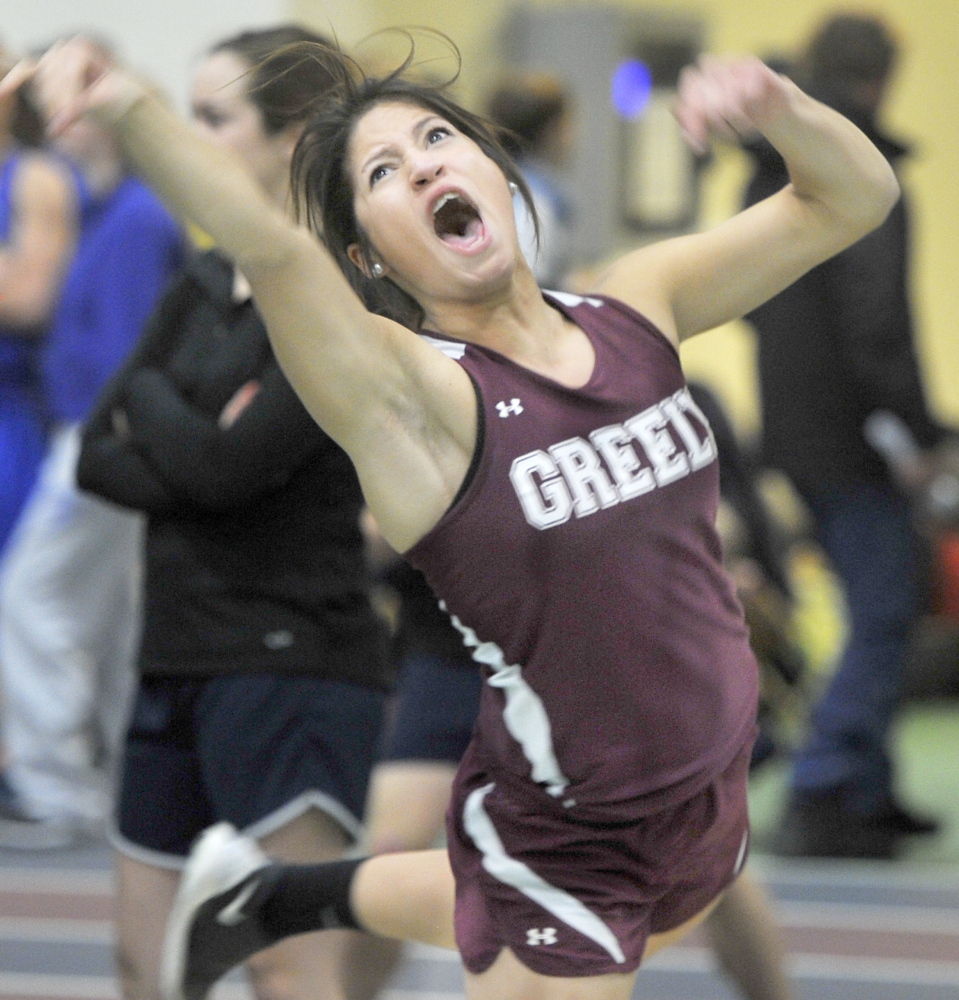 Alyssa Coyne of Greely lets out a yell as she throws the shot put during the Western Maine Conference indoor track and field championships in Gorham Friday. Coyne won with a throw of 39-1 and also was victorious in the pole vault.