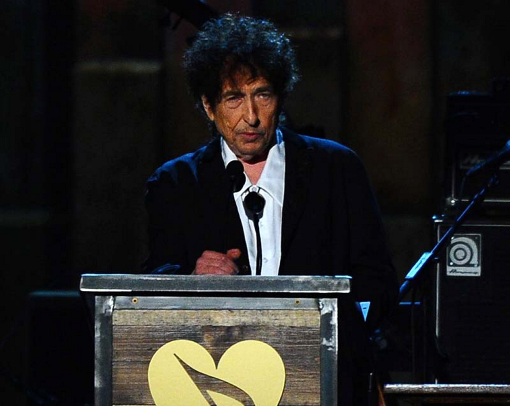 Bob Dylan accepts the 2015 MusiCares Person of the Year award on stage at the 2015 MusiCares Person of the Year show at the Los Angeles Convention Center on Friday.