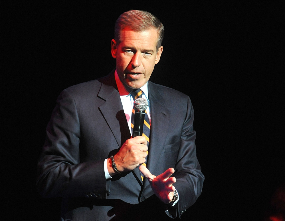 FILE - In this Nov. 5, 2014 file photo, Brian Williams speaks at the 8th Annual Stand Up For Heroes, presented by New York Comedy Festival and The Bob Woodruff Foundation in New York. NBC News has assigned the head of its own investigative unit to look into statements made by the anchor Williams about his reporting in Iraq a dozen years ago. A source at the network who requested anonymity because the person is not authorized to speak on personnel matters confirmed the investigation on Friday, Feb. 6, 2015.  (Photo by Brad Barket/Invision/AP, File)