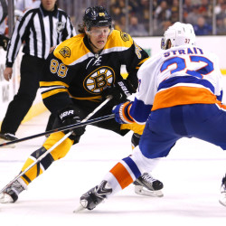 Boston's David Pastrnak, left, moves to get around Islanders defenseman Brian Strait during the second period of the Bruins' 2-1 victory at home on Saturday night. Boston has won nine of 12.