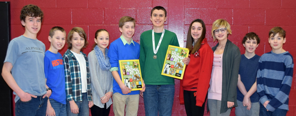 Wells Junior High contestants in the recent geography bee at the school include, from left, Wyatt Rowe, Covy Dufort, Garner Holdsworth, Katie Plourde, first runner-up Spencer Poulin, champion Matt Chase, Tori Hayward, Hannah Chase, Samuel Norbert and Guss Madsen.