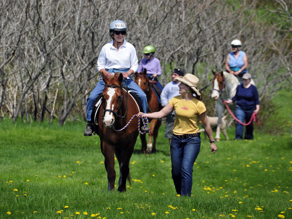 Seniors ride horses at Camp Ketcha in Scarborough, which also hosts about 3,000 youths each year. A state plan to tax nonprofits could force the camp to close, the director says.