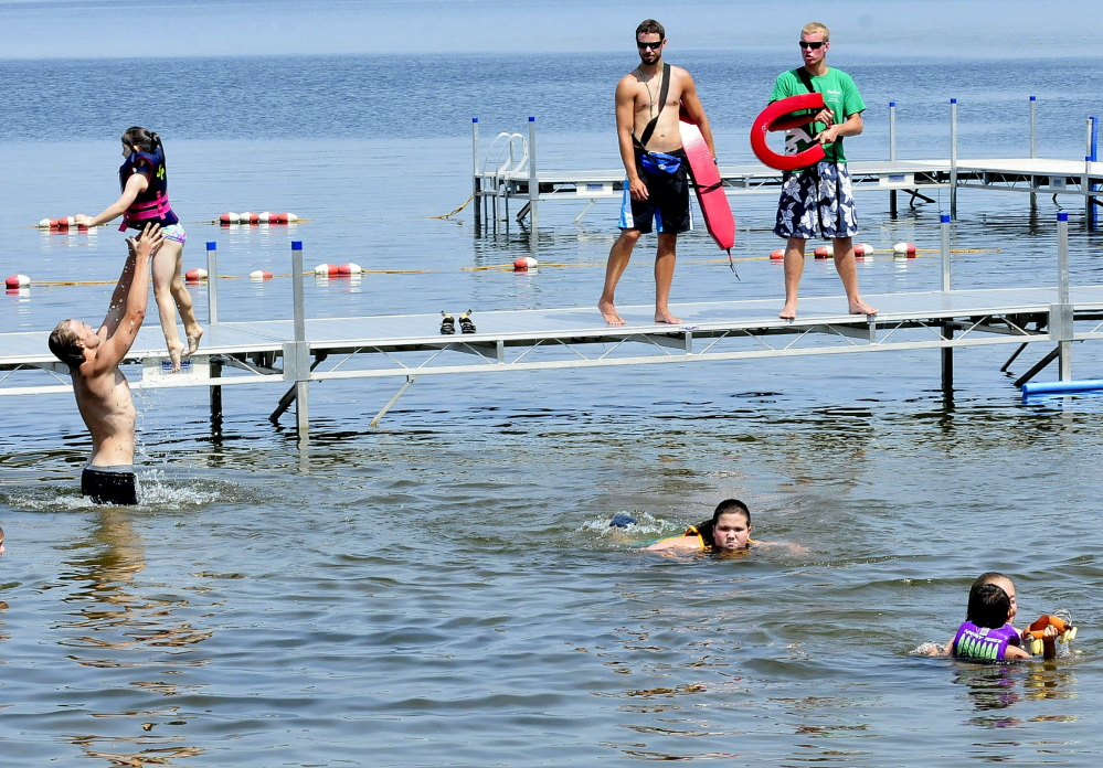 Campers cool off in North Pond at Pine Tree Camp in Rome in July. The camp, which serves people with disabilities, is among those that would be affected by Gov. Paul LePage's proposal to tax nonprofit institutions.