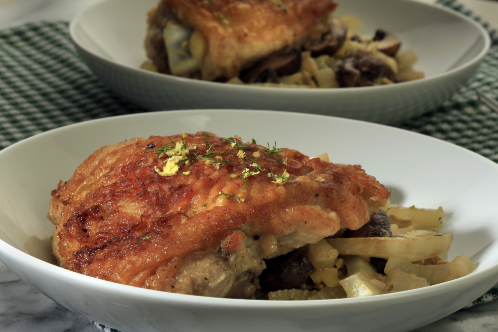 Chicken braised with fennel, mushrooms and olives.