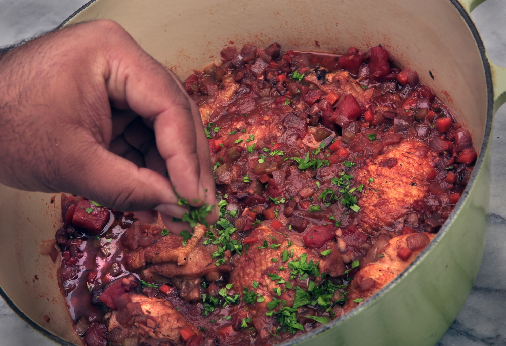 Chicken braised with pancetta and tomatoes is a flavorful version of poultry in a pot.