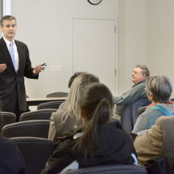 Glenn Cummings, one of three finalists for the job of president of the University of Southern Maine, speaks to a small gathering in the Abromson Community Center in Portland on Tuesday.