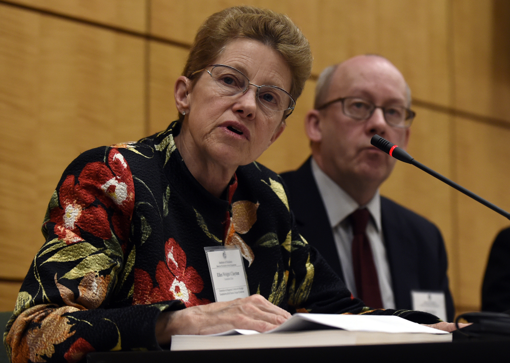 Dr. Ellen Wright Clayton, chair of the Committee on Diagnostic Criteria for Myalgic Encephalomyelitis/Chronic Fatigue Syndrome, left, speaks during an open meeting at the Institute of Medicine in Washington, Tuesday. Chronic fatigue syndrome is a real and serious disease that needs a new name to reflect that – and a straightforward way to diagnose the illness, a government advisory group declares.  The Associated Press