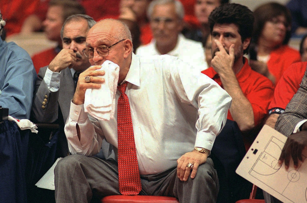 Jerry Tarkanian watches his Fresno State team play in 1995. Tarkanian, who built a basketball dynasty at UNLV but was defined more by his decades-long battle with the NCAA, died Wednesday in Las Vegas after several years of poor health.