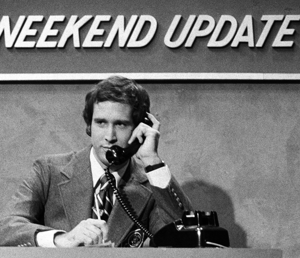 "Original ""SNL"" cast member Chevy Chase in ""Weekend Update."""