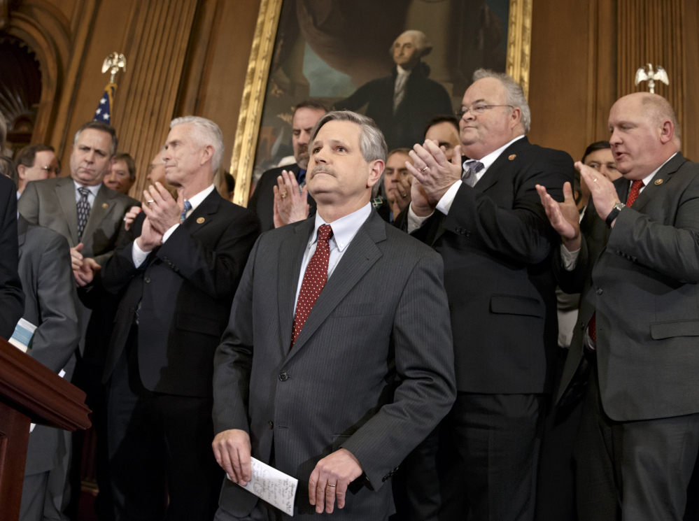 Sen. John Hoeven, R-N.D., sponsor of the Senate version of the Keystone XL pipeline bill, is applauded Wednesday as he and other lawmakers urge President Obama to sign the legislation passed in the House and Senate approving the project.
