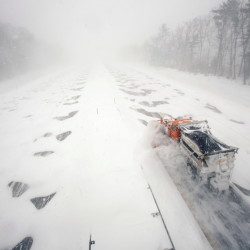 "A plow clears a northbound lane of the Maine Turnpike in Kennebunk during the Jan. 27 blizzard. ""We plan for winters like this,"" said Peter Mills, the Maine Turnpike Authority's executive director."