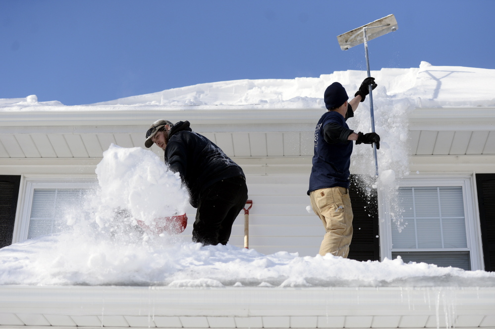 A more significant danger than snow buildup, engineers say, are clogged gutters and ice dams on roofs. As more melting snow is blocked by the ice dams, water can seep under the shingles and leak inside a house.