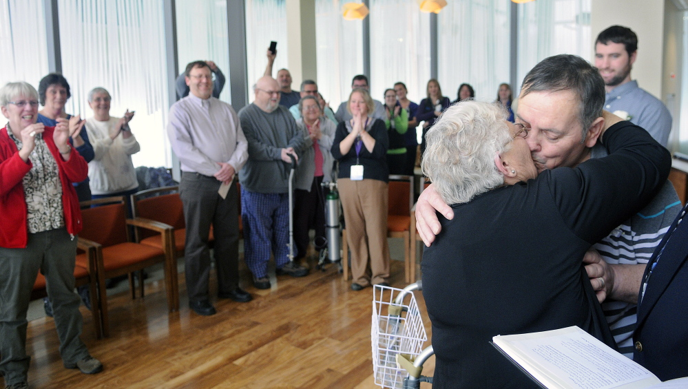Alan Gosselin kisses his bride, Esther Harris, after exchanging wedding vows Thursday at the Spiritual Center at MaineGeneral Medical Center in Augusta.