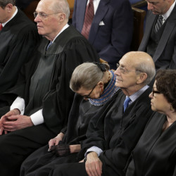 "Supreme Court Justice Ruth Bader Ginsburg, center, dozes during President Obama's State of the Union address on Jan. 20. Ginsburg told an audience Thursday that she ""wasn't 100 percent sober"" at the speech, after drinking wine at dinner beforehand."