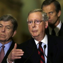 Senate Minority Leader Mitch McConnell, R-Ky., flanked by Sens. Roy Blount, R-Miss., left, and John Thune, R-S.D., faces a possible shutdown.