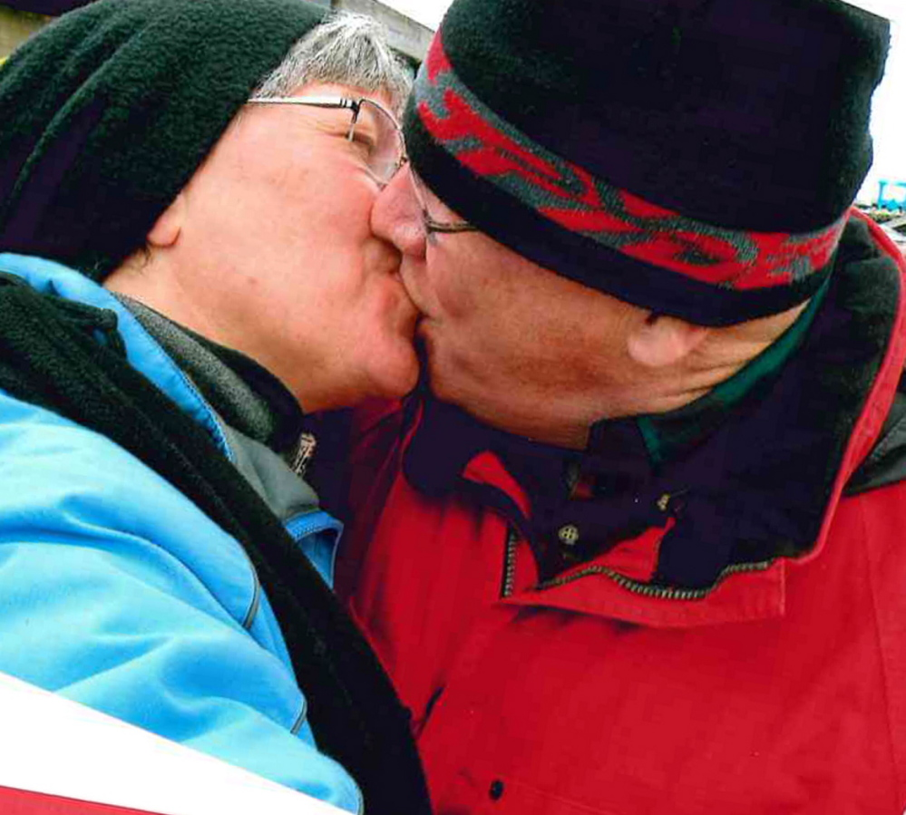 Peter and Ellen Tompkins of Waterville share a moment during a visit to the Camden waterfront on one of a continuing series of Valentine's Day celebrations that bring seven couples  together every year.
