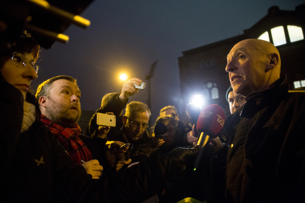 Senior police inspector Jorgen Skov, right, speaks during a news conference, after shots were fired at a cafe in Copenhagen, Denmark, on Saturday in a likely terrorist attack.