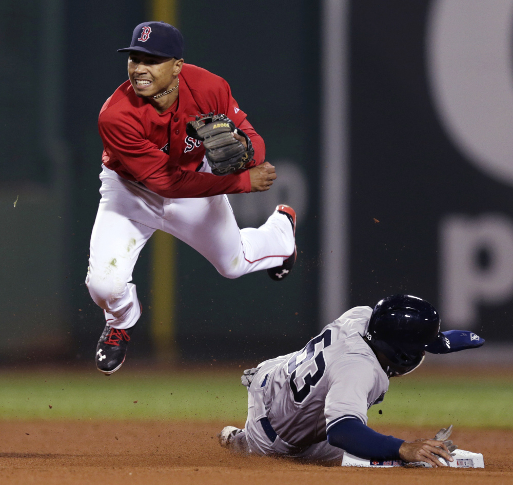Mookie Betts played some second base for Boston last season, among many other positions.
