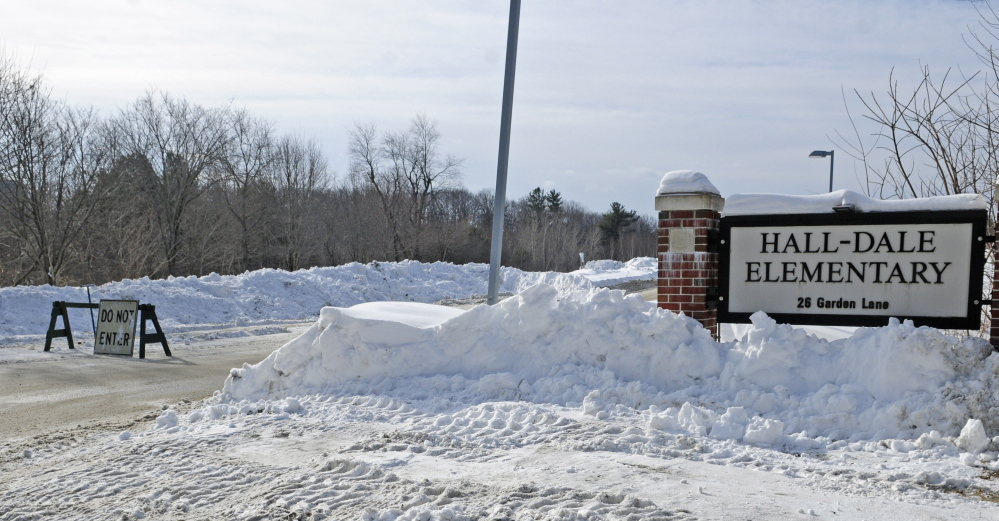 A barricade blocks Garden Lane in Hallowell, the driveway to Hall-Dale Elementary School, after an early-morning natural gas leak on Feb. 7. The leak was caused by a contractor's loader striking a gas pipe attached to the school while removing snow.