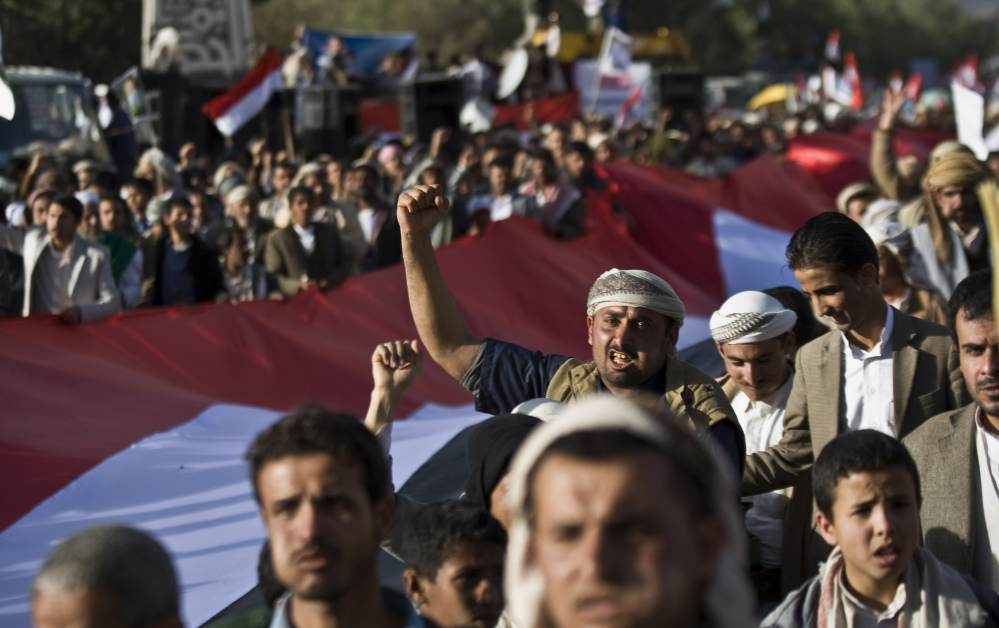 Houthi Shiite supporters celebrate the fourth anniversary of the uprising in Sanaa, Yemen. The U.N. Security Council on Sunday demanded that rebels give up control of Yemen.