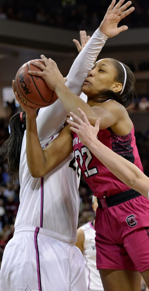 South Carolina's A'ja Wilson, center, drives to the basket while being fouled by Vanderbilt's Marqu'es Webb during the Gamecocks' 89-59 win Sunday.
