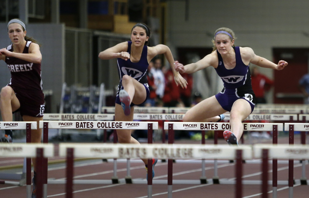 FEB. 16: CLASS B GIRLS INDOOR TRACK Sarah Shoulta, right, of Waterville races ahead of teammate Kellie Bolduc, center, and Jocelyn Mitiguy of Greely in the 55-yard hurdles final. Shoulta won in 8.79 seconds, and also captured the pole vault at 9 feet, 6 inches to help the Purple Panthers win their fifth consecutive team championship.