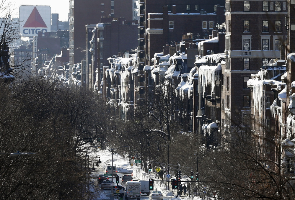 Icicles hang from buildings on Beacon Street in Boston on Monday. For Boston commuters, the situation goes from bad to infuriating as trains are delayed or canceled after an unprecedented succession of heavy snows.