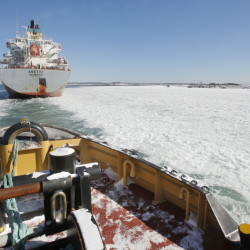 The tug Andrew McCallister follows the Anette, a cargo ship that carried clay to South Portland, through a frozen Portland Harbor on Friday.