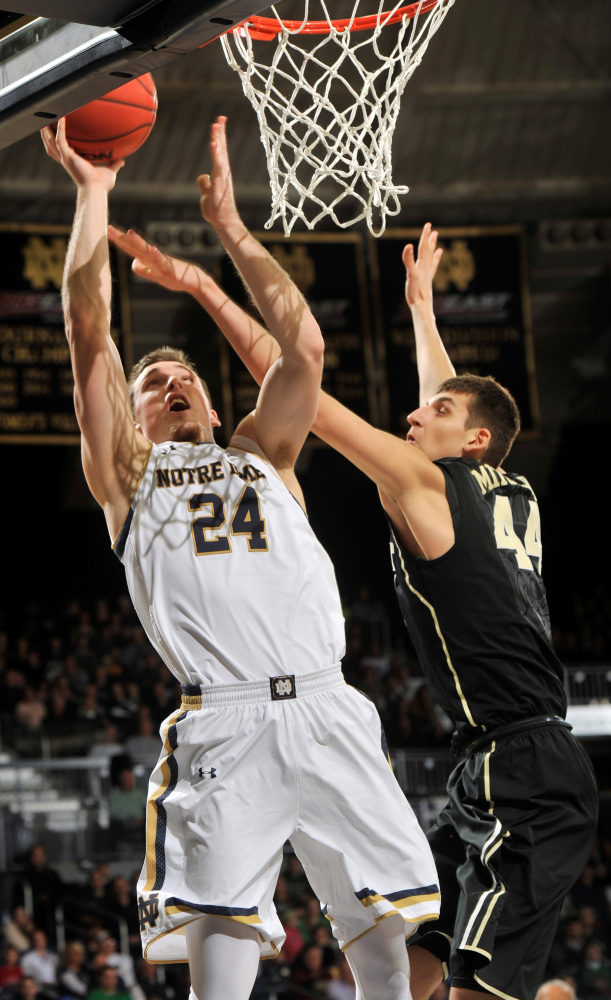Notre Dame guard Pat Connaughton puts up a shot as Wake Forest forward Konstantious Mitoglou defends on Tuesday night.