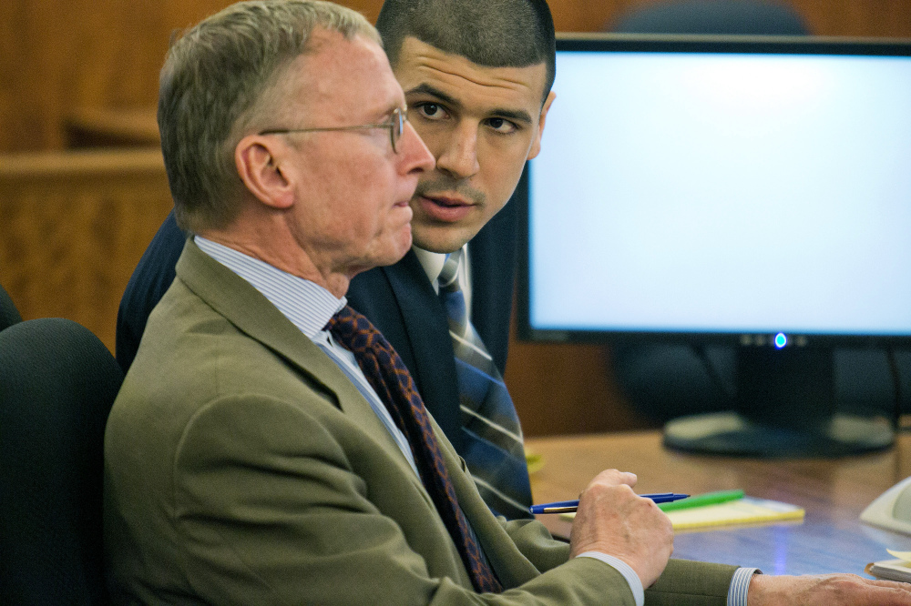 Aaron Hernandez, right, consults with defense attorney Charles Rankin during his murder trial at the Bristol County Superior Court in Fall River, Mass., on Wednesday. Hernandez is accused in the June 17, 2013, killing of Odin Lloyd.