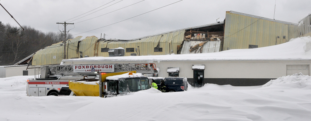 A warehouse-style building at Foxborough Terminals in Foxborough, Mass., collapses from the weight of snow on the roof, which gave way on Sunday.