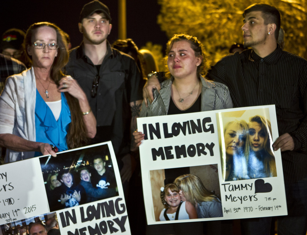Participants in Tuesday's candlelight vigil for Tammy Meyers mourn the woman taken off life support on Saturday after a Las Vegas shooting. Police say the killing has morphed into a more complex scenario, prompting a backlash against Meyers' family.