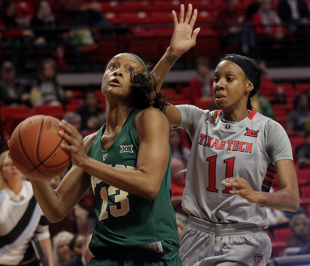 Baylor's Nina Davis shoots ahead of Texas Tech's Rayven Brooks in Wednesday's game at Lubbock, Texas. Davis had 12 points as Baylor won its 24th straight, 67-60.