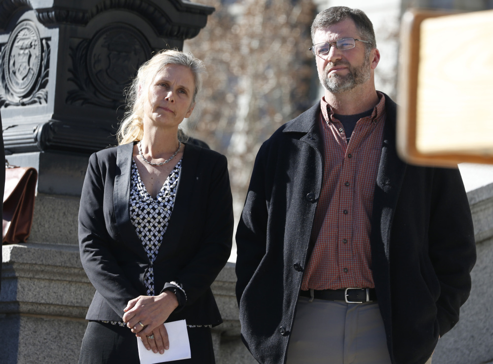"""Hope and Mike Reilly of Pueblo, Colo.,  say a marijuana cultivation facility next to their farm has marred their """"spectacular views"""" of the Rocky Mountains. The Reillys are suing in U.S. District Court over the legalization of marijuana."""