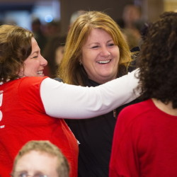 Striking FairPoint employees Renee Dugas, left, and Erin Thibodeau have a celebratory embrace before a meeting to vote on a tentative contract agreement at the Fireside Inn in Portland on Friday.