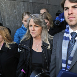 Former Virginia first lady Maureen McDonnell, center, leaves federal court with her son Bobby, right, and daughter Cailin Young, left, after being sentenced to one year and one day on corruption charges in Richmond, Va., on Friday.