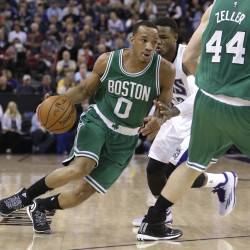 Boston Celtics guard Avery Bradley uses a screen by teammate Tyler Zeller, right, to shake off Sacramento Kings guard Ben McLemore during the first quarter of Friday night's game in Sacramento, Calif. The Kings won, 109-101.