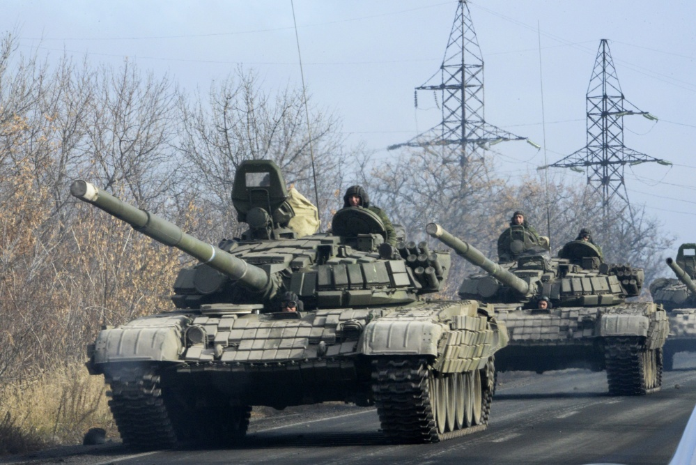 In this file photo Pro-Russia rebels lide a highway in Ukraine.