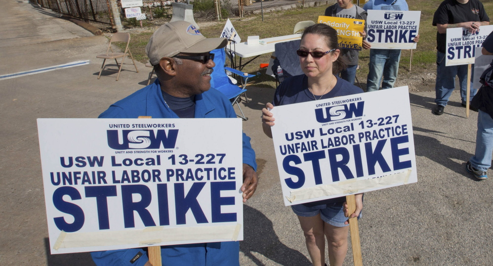 Workers from the United Steelworkers picket outside the Lyondell-Basell refinery in Houston.
