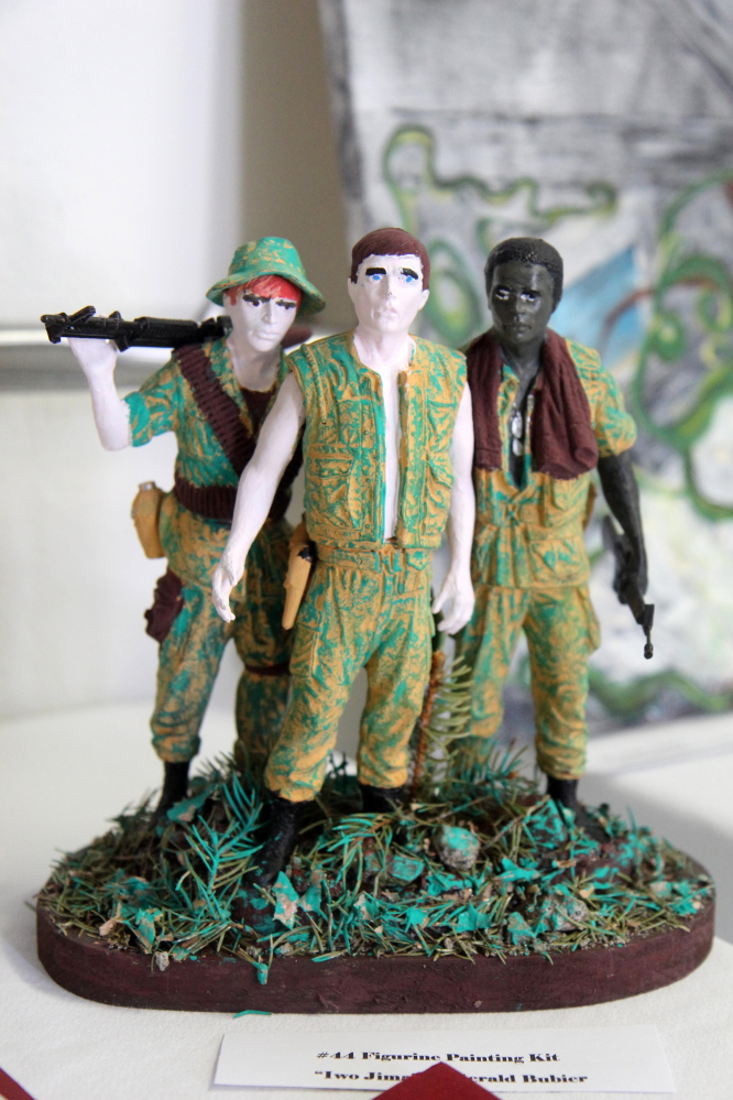 """A figurine group titled """"Iwo Jima,"""" completed by Gerald Bubier, stands on display Saturday at the 2015 Maine Veterans Creative Arts Festival."""
