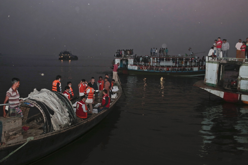 Bangladeshi rescue workers bring dead bodies of victims in a boat after a river ferry carrying about 100 passengers capsized Sunday after being hit by a cargo vessel,in Manikganj district, about 25 miles northwest of Dhaka, Bangladesh, on Sunday.