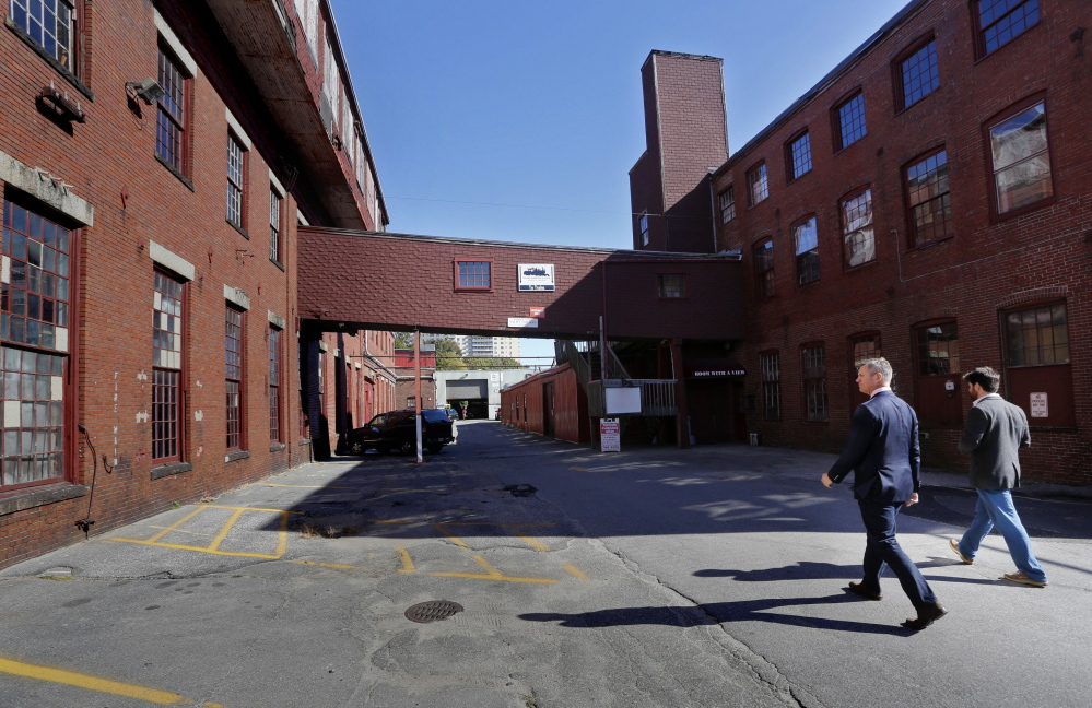 James Brady, left, and Casey Prentice, owners of the former Portland Co. complex, walk around the site in October.