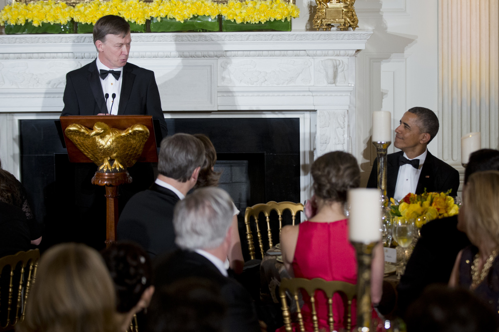 National Governors Association Chairman, Colorado Gov. John Hickenlooper, left, glances at President Barack Obama, right, as he speaks during the National Governors Association, 2015 Governors' Dinner reception in the State Dining Room at the White House in Washington, Sunday.