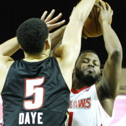 Maine's Andre Stringer goes up for a shot while being defended by Erie's Austin Daye during the Red Claw's 120-92 win Sunday at the Portland Expo. Stringer scored 19 points. PORTLAND, ME - FEBRUARY 22: Maine Red Claws #11 Andre Stringer goes up for a shot with defense from Erie #5 Austin Daye vs. Erie Bayhawks Sunday, February 22, 2015 at the Portland Expo.